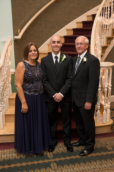 Formal shot of groom and his parents