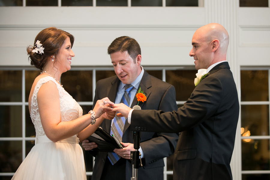 Couple exchange rings during Mendenhall Inn wedding