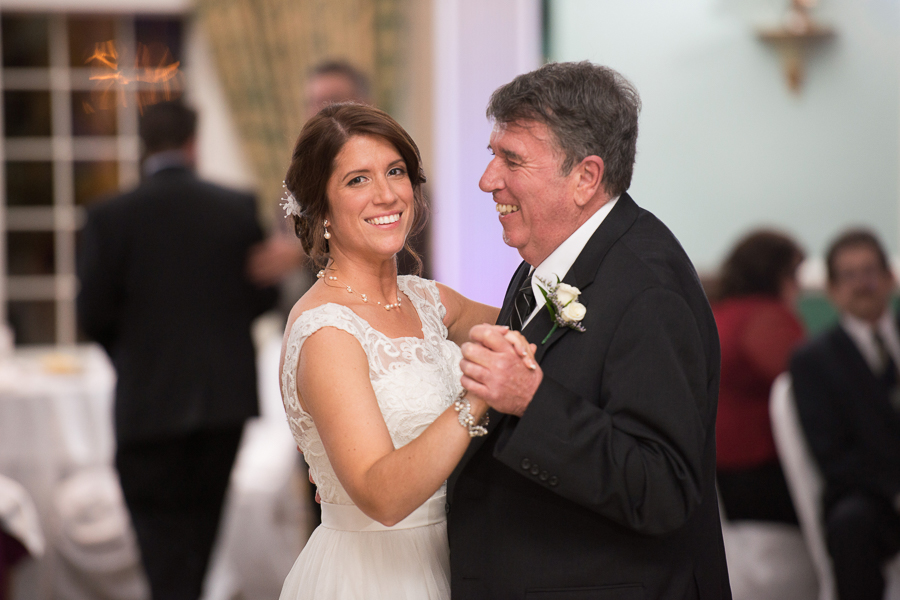Father daughter dance dad smiling at the bride