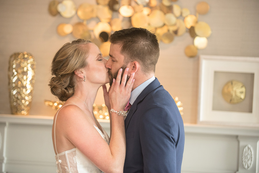 Bride and groom kiss after seeing each other for the first look