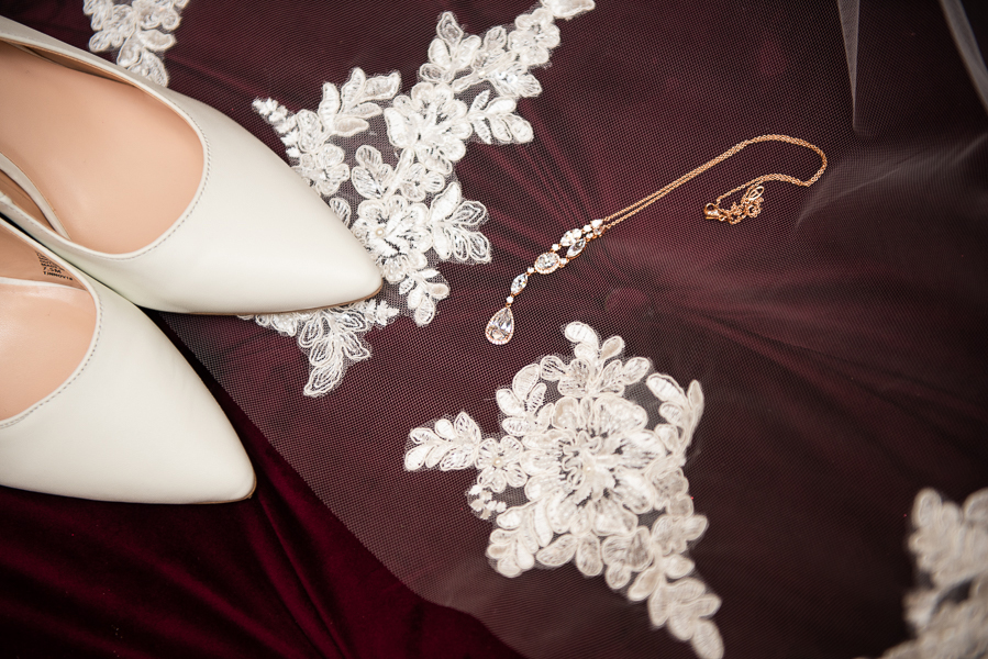 close of up veil, wedding shoes and jewelry