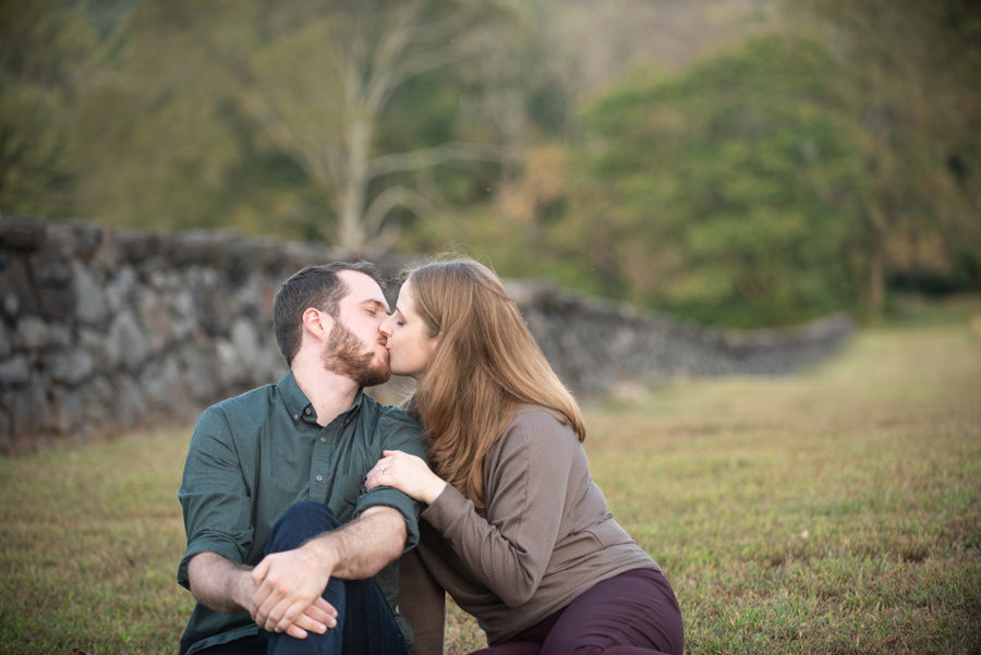 Engaged couple kissing at Brandywine Creek State Park
