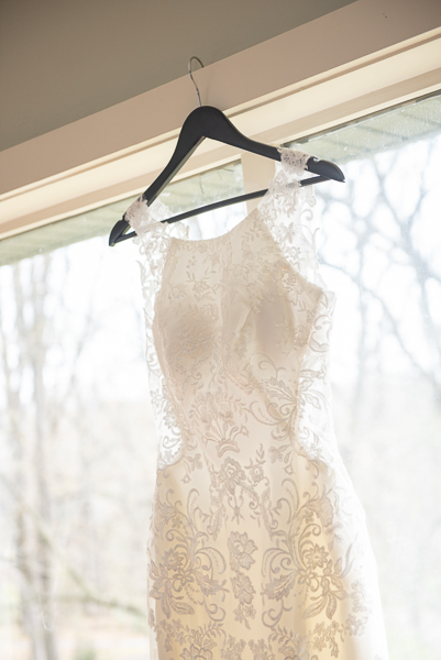 Wedding gown hangs in window in Landenberg PA home