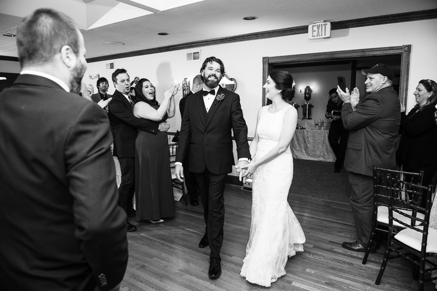 Black and white picture of bride and groom entering their reception at The Farmhouse in Delaware