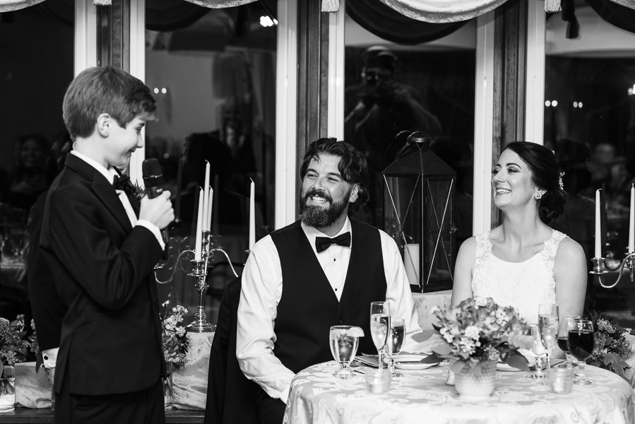 Black and white photo of the groom's son giving a toast at The Farmhouse in Delaware