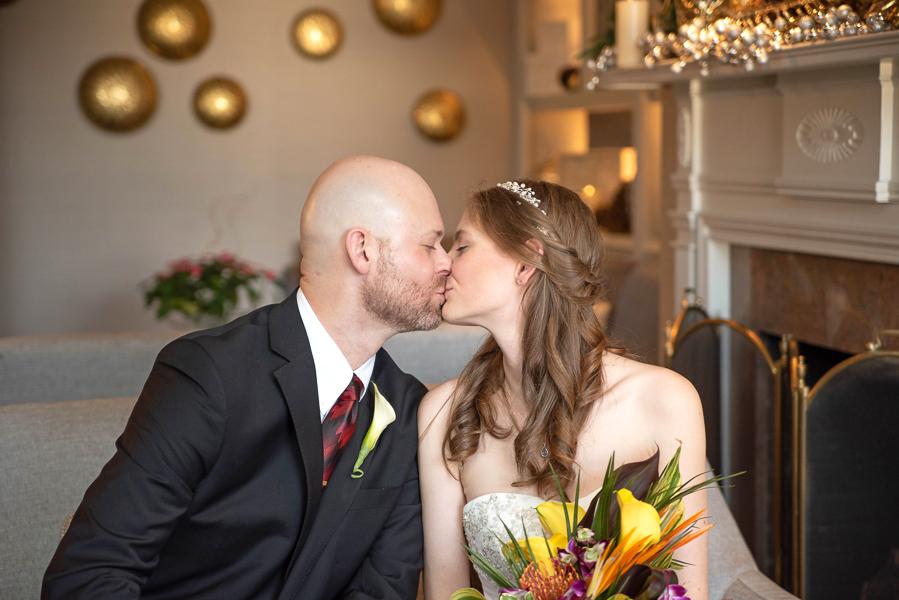 Bride and groom share a kiss before Hilton Christiana wedding ceremony