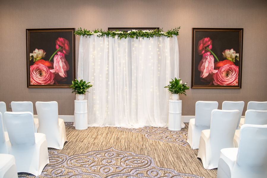 Indoor ceremony set up for a December Hilton Christiana wedding