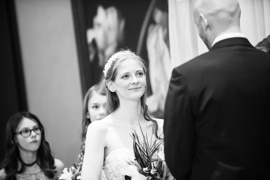 Black and white image of bride looking at groom during Hilton Christiana wedding ceremony