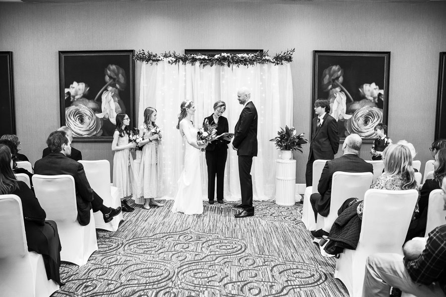 Wide black and white shot during December Hilton Christiana wedding ceremony