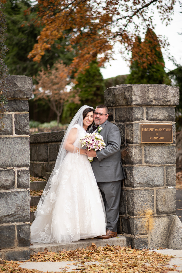 November wedding bride and groom at University and Whist Club front wall