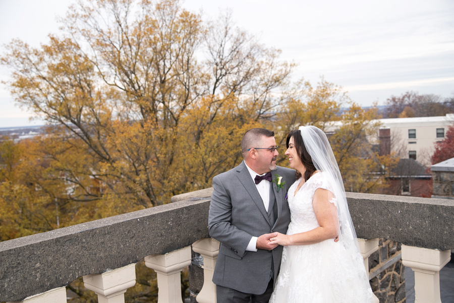 Bride and groom on Wilmington rooftop in November