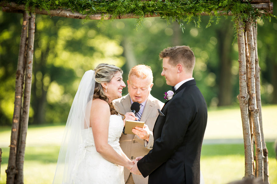 Bride and groom smile at each other during Deerfield wedding ceremony