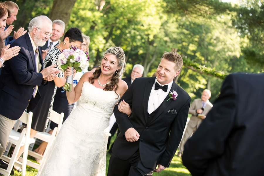 They are married! Walking down the aisle after outdoor ceremony at Deerfield Golf Club