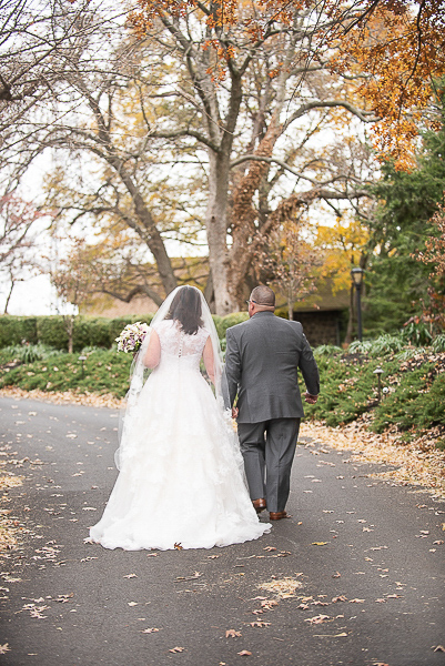 bride and groom walk away on driveway of the University and Whist Club