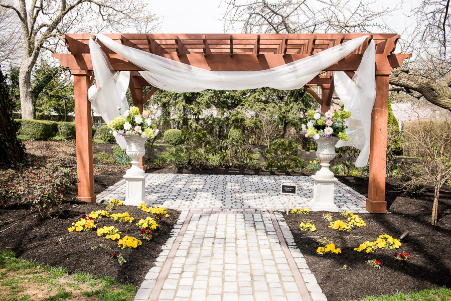 Pergola decorated for an outdoor ceremony