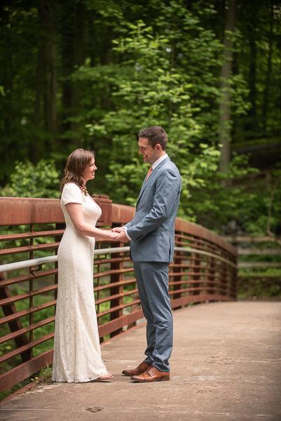 Bride and groom on bridge before intimate Delaware ceremony