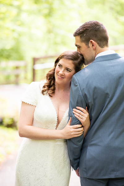 Bride rests head on groom's shoulder