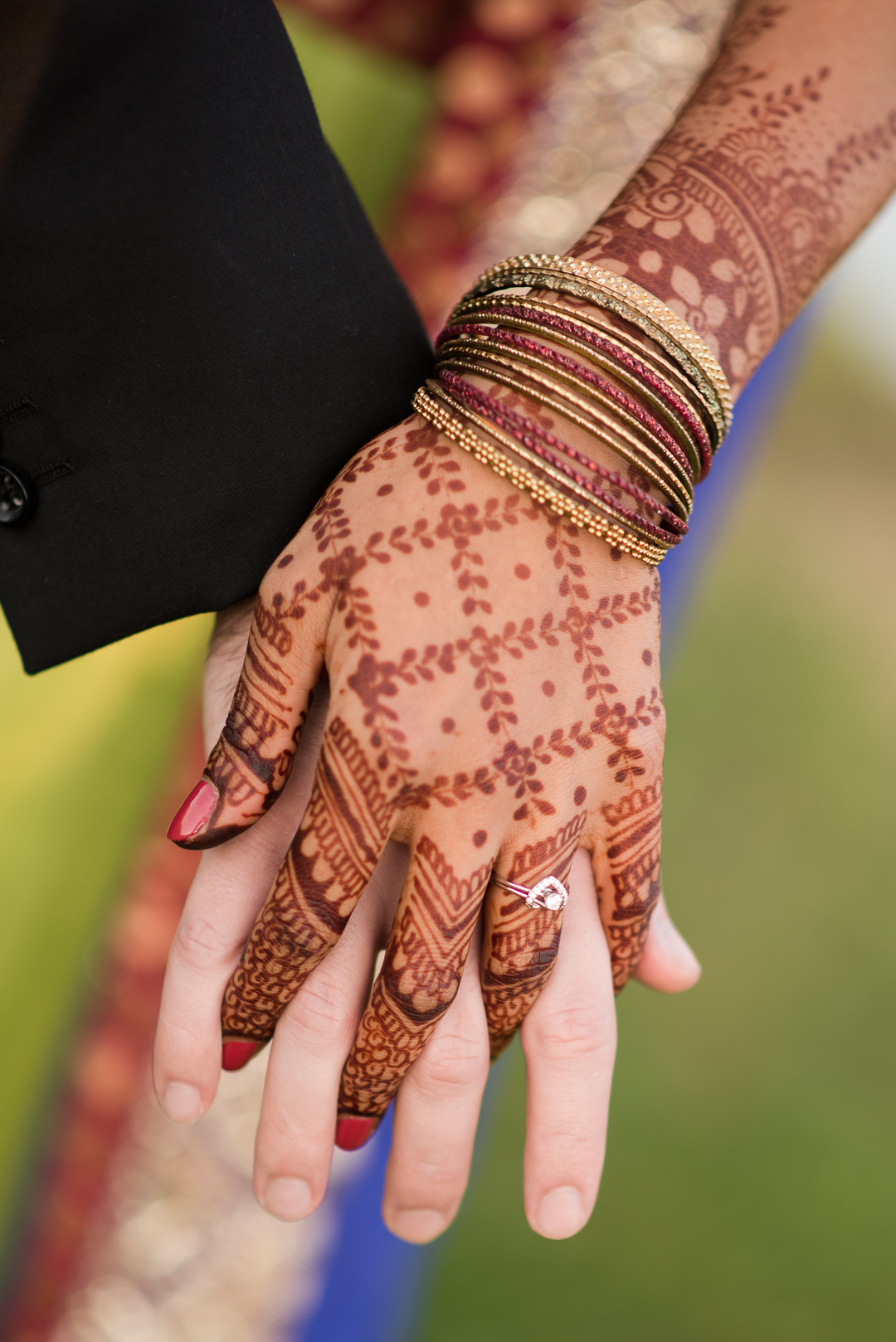 Henna artwork with engagement ring