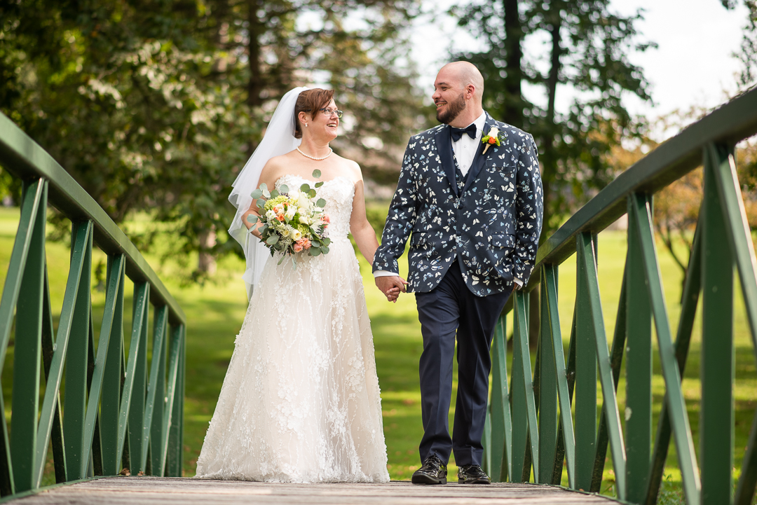 bride and groom walk after first look