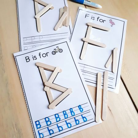 Use hands-on activities like these popsicle stick letter work mats to reinforce the alphabet. A perfect literacy center for your kindergarten students.