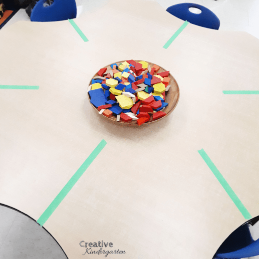 Line of symmetry math provocation for kindergarten. Use this simple activity to work on making symmetrical pictures with pattern blocks.