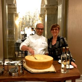 Cozying up to Head Chef Alessio Corda as he prepares his signature dish, Risotto Mantecato, prepared in a wheel of Parmigiano-Reggiano.