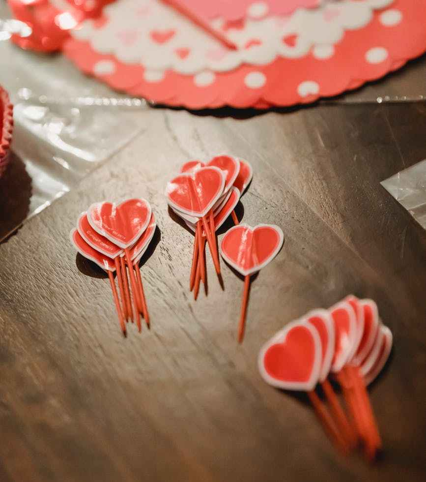 red heart decorations on wooden table