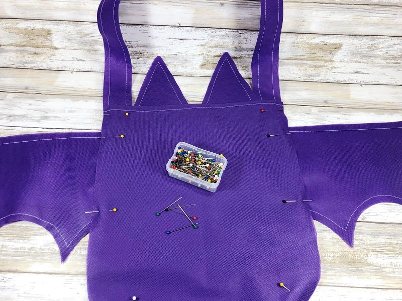 Creatively Beth pin wings and handle onto bag base and sew all pieces together