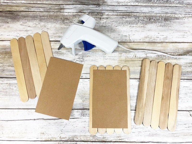 Attach craft sticks to paper Craft Stick Arctic Animals Creatively Beth #creativelybeth #craftstickcrafts #dollartreecrafts #kidscrafts