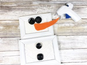 Attach carrot nose and buttons Dollar Tree Picture Frame Snowman Creatively Beth #creativelybeth #dollartreecrafts #snowmancrafts #kidscrafts #wintercrafts
