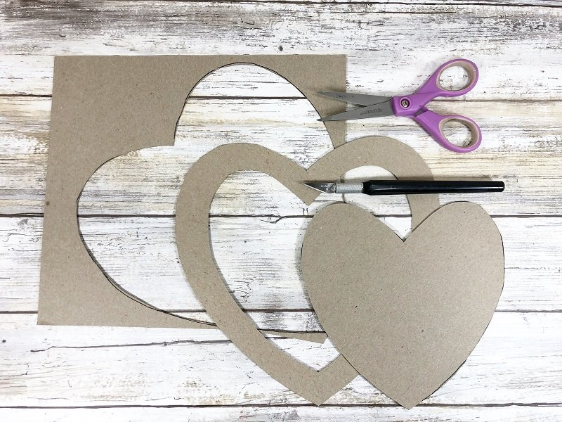 Download and cut out the template Puzzle Piece Heart Shaped Wreath Creatively Beth #creativelybeth #dollartreecrafts #heart #valentinesdaycrafts #kidscrafts