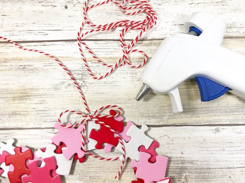 Accent with a bow Puzzle Piece Heart Shaped Wreath Creatively Beth #creativelybeth #dollartreecrafts #heart #valentinesdaycrafts #kidscrafts