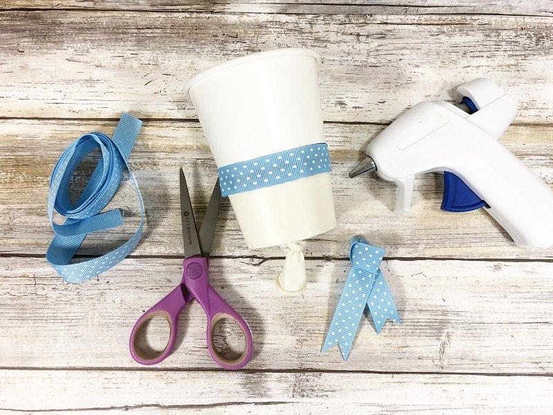 Decorate with ribbon scarf Snowman Pom Pom Popper Creatively Beth #creativelybeth #dollartreecrafts #pompom #snowman