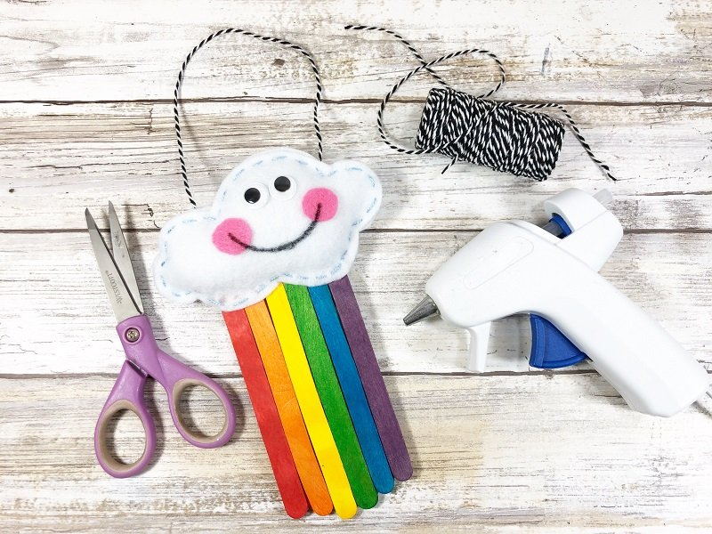 Measure and cut a bakers twine hanger to the Rainbow Creatively Beth #creativelybeth #rainbow #craftweek2020 #craftsticks #kidscraft