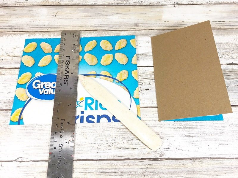 Score cardboard notebook covers with a bone folder and ruler #creativelybeth #recycled #crafts #notebooks #journals #upcycled