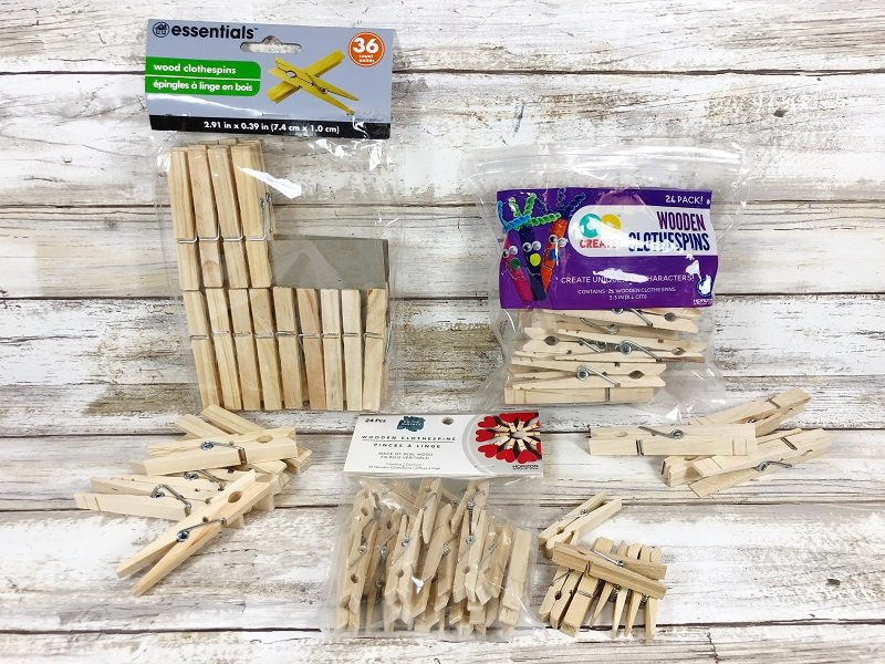 Materials needed for DIY Glittery Clothespin Snowflake a Dollar Tree Christmas in July Craft Creatively Beth #creativelybeth #christmasinjuly #christmasornament #dollartreecraft #snowflake #clothespin