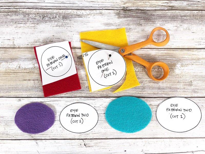 Pin and cut eye patterns from scraps of colored felt Creatively Beth #creativelybeth #toothfairy #fairfieldworld #80daysofpolyfil #polyfil #felt #monster #craft