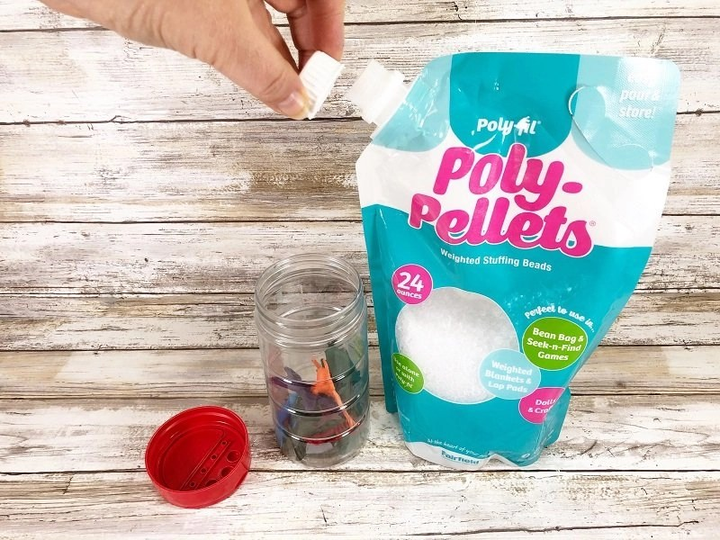Poly-Pellets have a easy pour spout and re-closable lid by Creatively Beth #creativelybeth #sensorybottle #freeprintable #wordsearch #doodles #madewithFFW