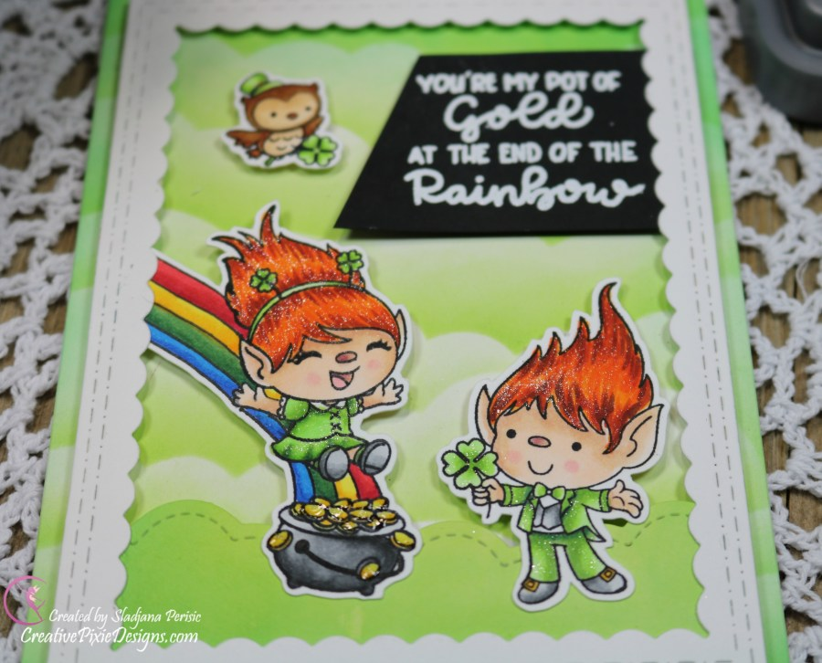 Craftin Desert Diva Pot of Gold stamp set colored with Copic markers set against a cloud background made by ink blending with Distress Oxide inks in Mowed Lawn and Lucky Clover, St. Patricks' Day card.