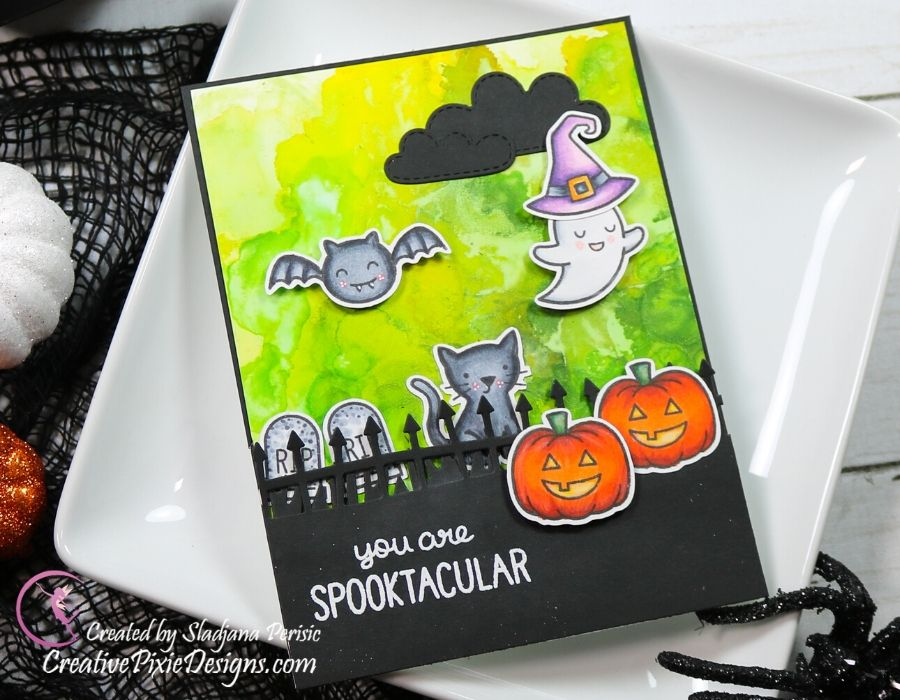 Lawn Fawn Spooktacular Stamp set colored with Copic Markers combined with Lawn Fawn Spook Fence Border, Lawn Fawn Spring Showers and Lawn Fawn Grassy Border dies set against a Pearl Alcohol inked background. Handmade Halloween card. #LawnFawn #LawnFawnatics