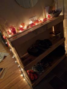 A few weeks back, my wonderful husband helped me build this shoe rack. I had no directions or plan, just ideas in my scattered head. He helped put my ideas into an actual piece of work. Some simple white lights and a strand of fall leaves. P.S. I bought these white lights from Walmart on New Years Eve. Sounds strange but they were trying to clear their shelves so I got them for $1 when normally they were like $15. So if you have no plans on New Years Eve, just go buy Christmas lights. :P