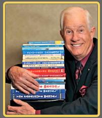 Photo of Dan Poynter with books