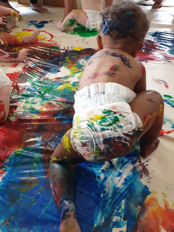 baby playing in paint