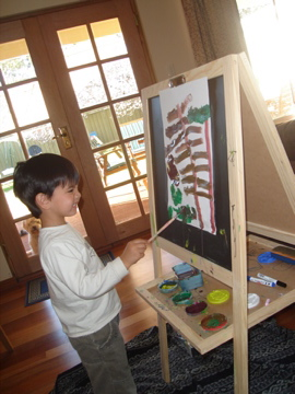 C, aged 3, painting at home