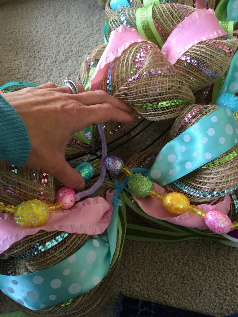 Twisting in the Easter egg garland.