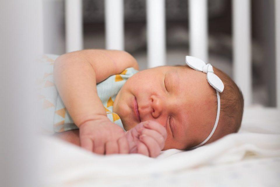 Newborn Baby Photography in White Crib