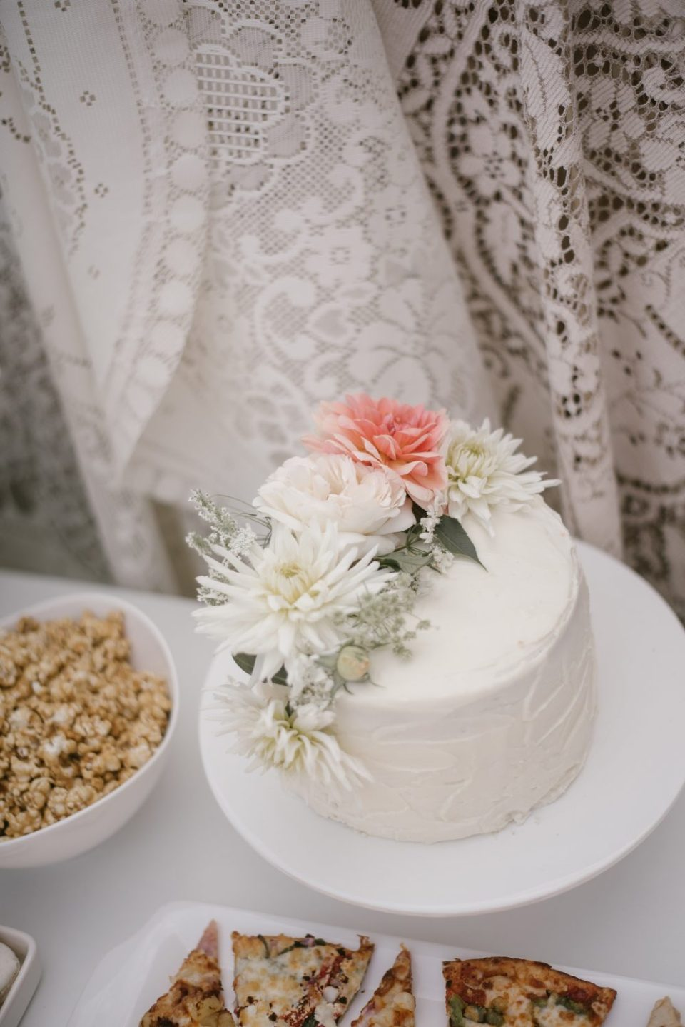 White floral cake at lace and boho baby shower   White Boho Baby Shower
