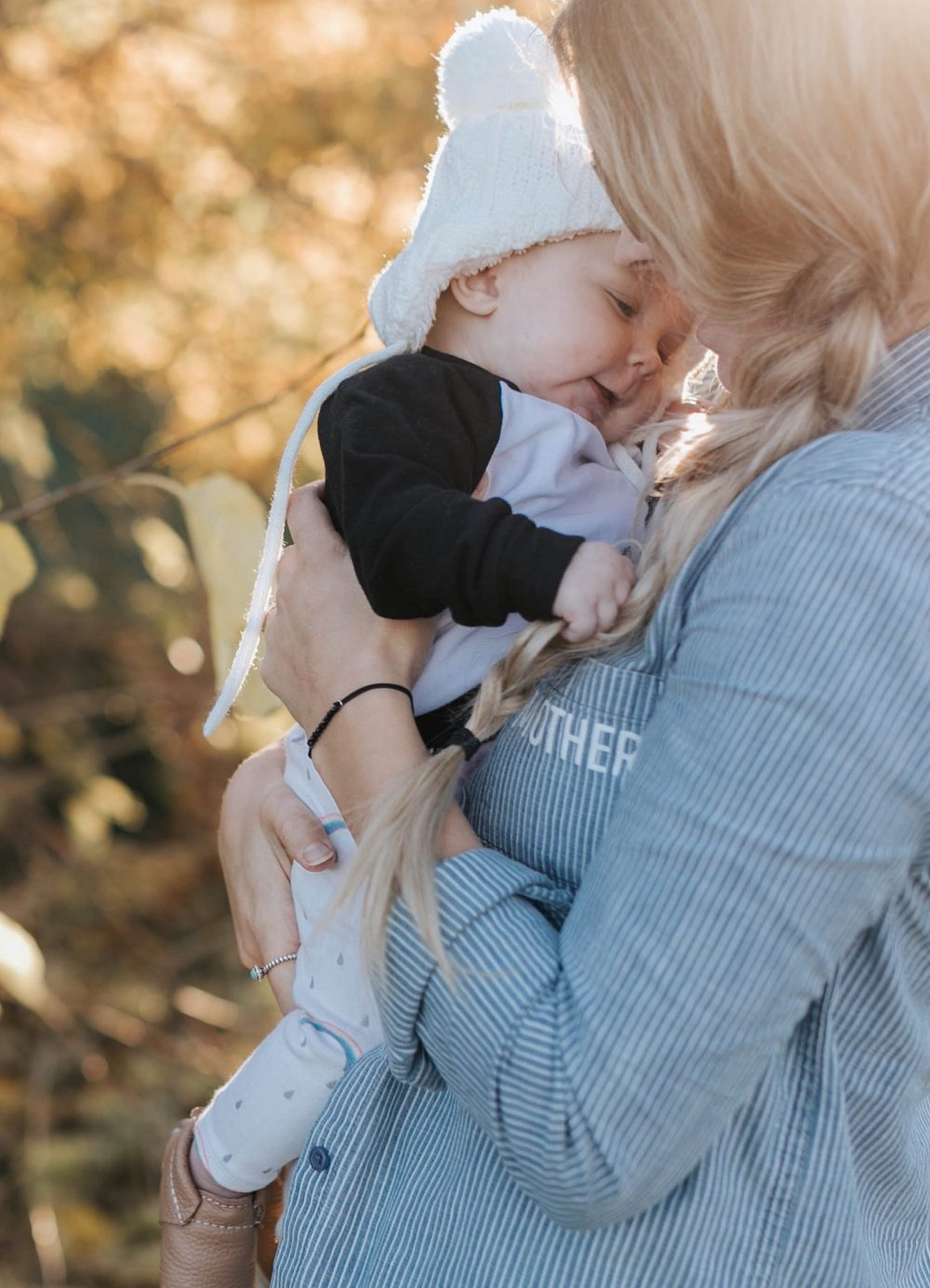 Stylish Mother and Baby in Organic Clothing and knitted toque