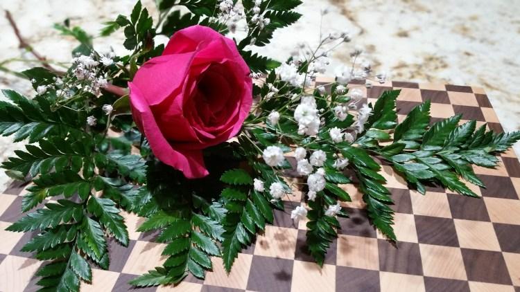 Dizzy Cutting Board with Rose