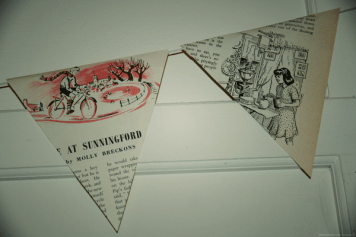 beautiful bunting made from old books - idea from prettymuchpenniless.com